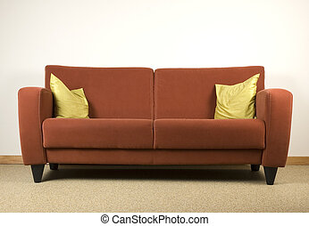 Couch - Simple image of a red couch with two yellow pillows.