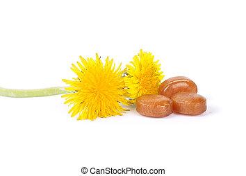 Cough drops with dandelion flowers