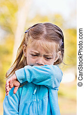 Coughing or sneezing into arm - Little girl demonstrates...