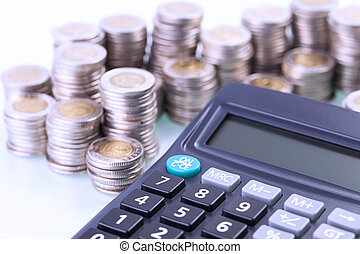 Couns and calculator on white background