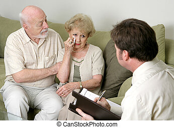 Counseling - In Tears - A senior couple in counseling -...