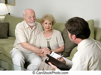 Counseling or Sales Pitch - A senior couple talking with a...
