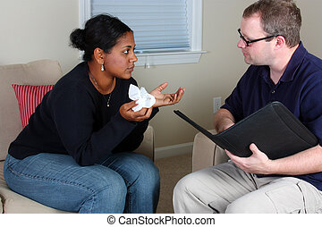 Counseling - Woman getting counseling while in an office