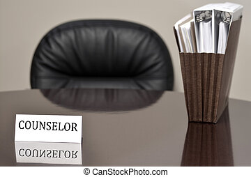 Counselor Business Card on Desk with Files