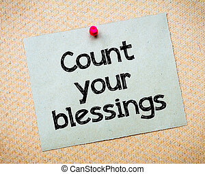 Count your blessings Message. Recycled paper note pinned on...
