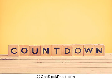 Countdown sign with wooden blocks