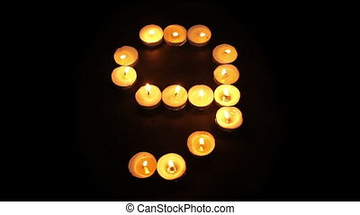 Countdown Timer With Tealight Candles - A close up shot of a...