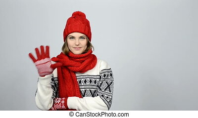 Countdown to holiday. Smiling winter woman counting in...
