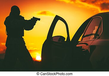 Counter Terrorism Check Point. Hunt For Terrorists. SWAT member in a Mask Pointing His Gun on Terrorist Member Inside Stopped Vehicle.