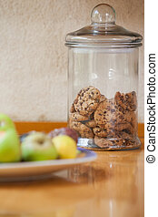 Counter top with cookies and fruit at home in the kitchen
