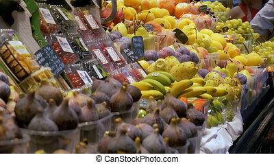 Counter with Fruits at a Market in La Boqueria. Barcelona. Spain