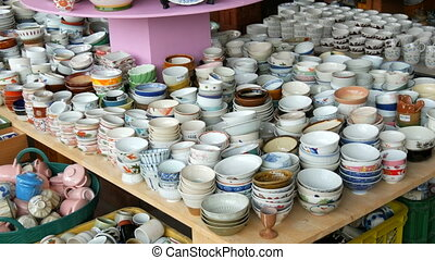 Counter with huge variety of porcelain dishes - Counter with...