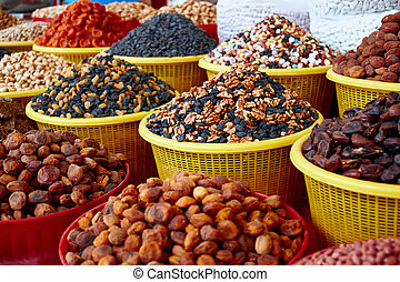 Counter with nuts and dried fruits on the market in Central Asia