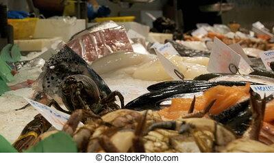 Counter with Seafood in La Boqueria Fish Market. Barcelona....