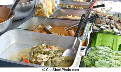 Counter with variety of Thai food. Meat, soups, salads....