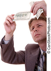 Counterfeit bill - Businessman in grey suit with money...