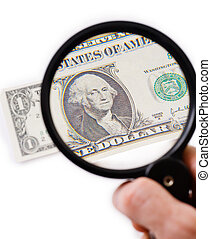 Counterfeit dollar on magnifier photographed on a white...