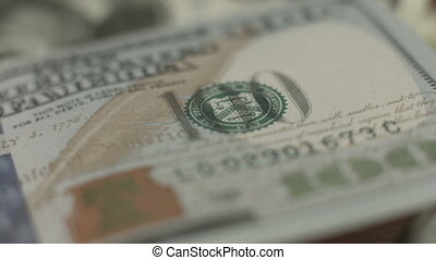"""Counterfeit money detection, new one hundred dollar bill..."
