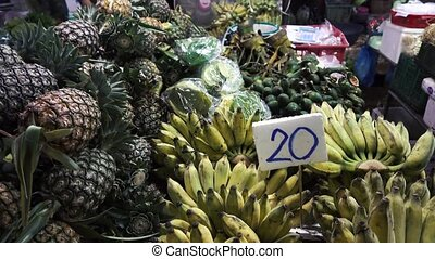 Countertops of fruit bananas and pineapple market -...
