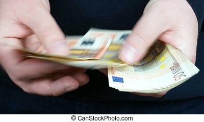 Counting 50 Euro banknotes - Man counting 50 Euro banknotes