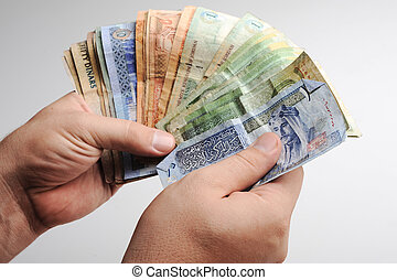 Counting arabic money in hands