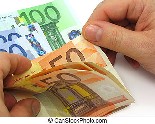 Man's hands counting euro notes