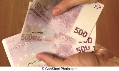 Counting five hundred euro banknotes - Man counting five...