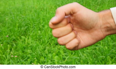 counting male hand on grass