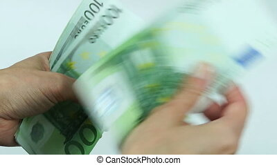 Counting many euro banknotes - Woman counts many euro...