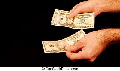 Counting money cash dollars bills in hands.