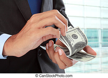 close up of businessman's hand counting money