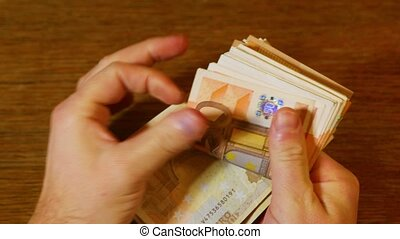 Counting money, Euro banknotes - Counting money in hand,...