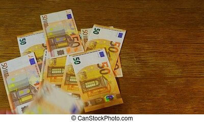 Counting money, Euros - Counting money, throwing 50 Euro...