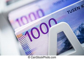 Counting Norwegian Krones Banknotes
