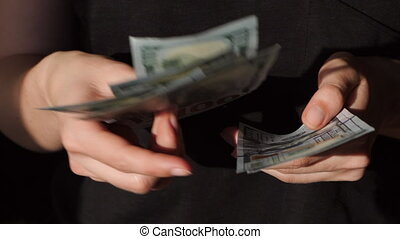 Counting US currency. Woman counts money. New dollars in hand. Slow motion.