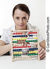 counting - young attractive woman using a wooden abacus to ...