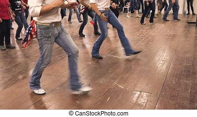 Country-dance at line dance celebration. Denim jeans, cowboy...