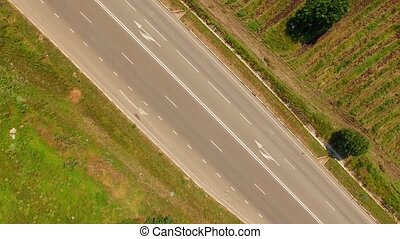 Country Freeway And Several Cars Moving Fast - AERIAL VIEW....