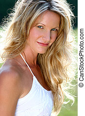 country girl - beautiful blonde model wearing white top....
