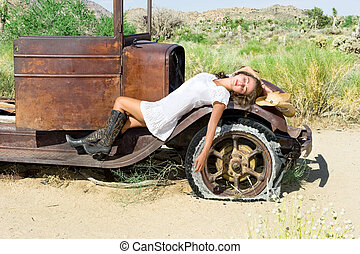 Country girl - A country girl resting on the fender of an...