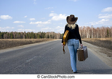 country girl with guitar goes on road solitary