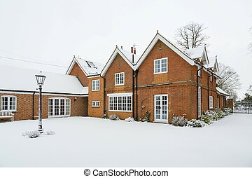 Country house in winter snow