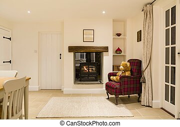 Country house interior with log fire