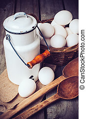 Country kitchen Still Life, enamel milk can, eggs in a...