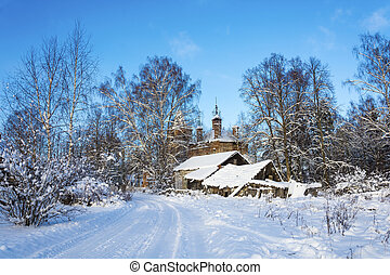 Country landscape with a ruined church on a frosty winter...