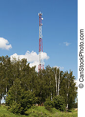 Country landscape with cellular tower - Cellular tower in a...