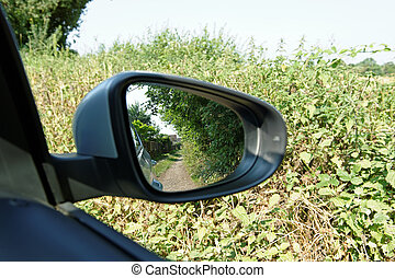 Country Lane in a Car Mirror