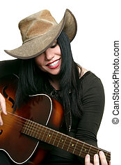 Country musician happily playing her acoustic guitar. Some motion in fingers and strings.
