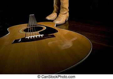 Country Music Icons - Selective focus on the guitar in the...