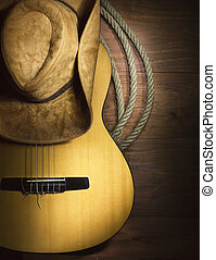 Country music with guitar on wood background - American...